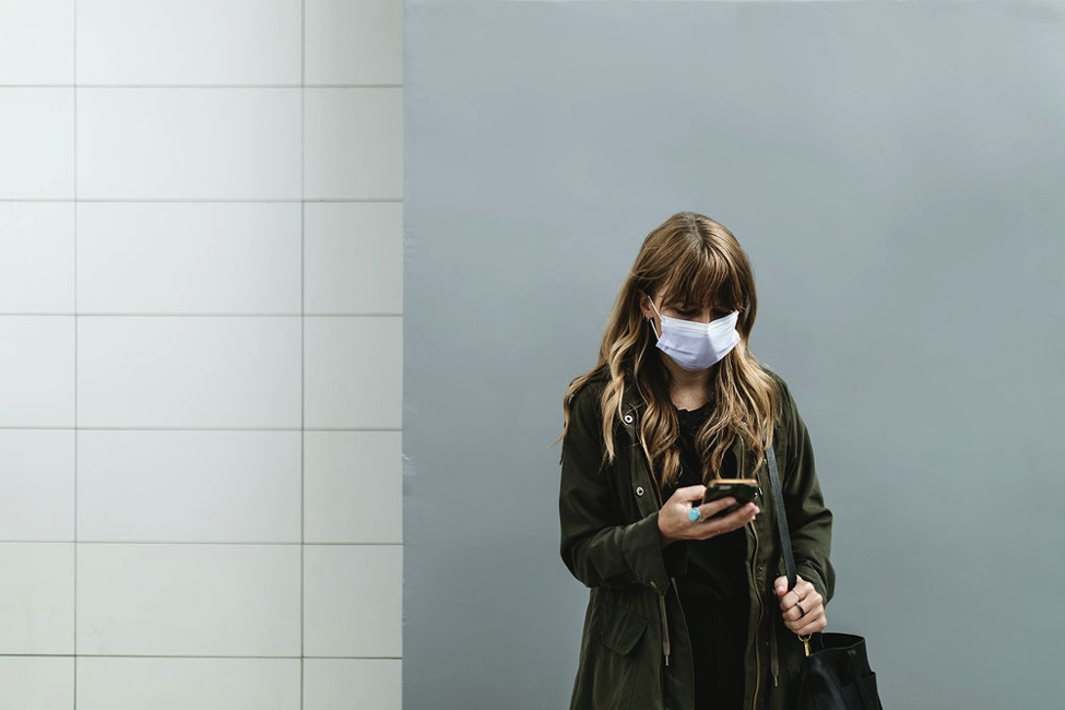 Lady on phone wearing mask